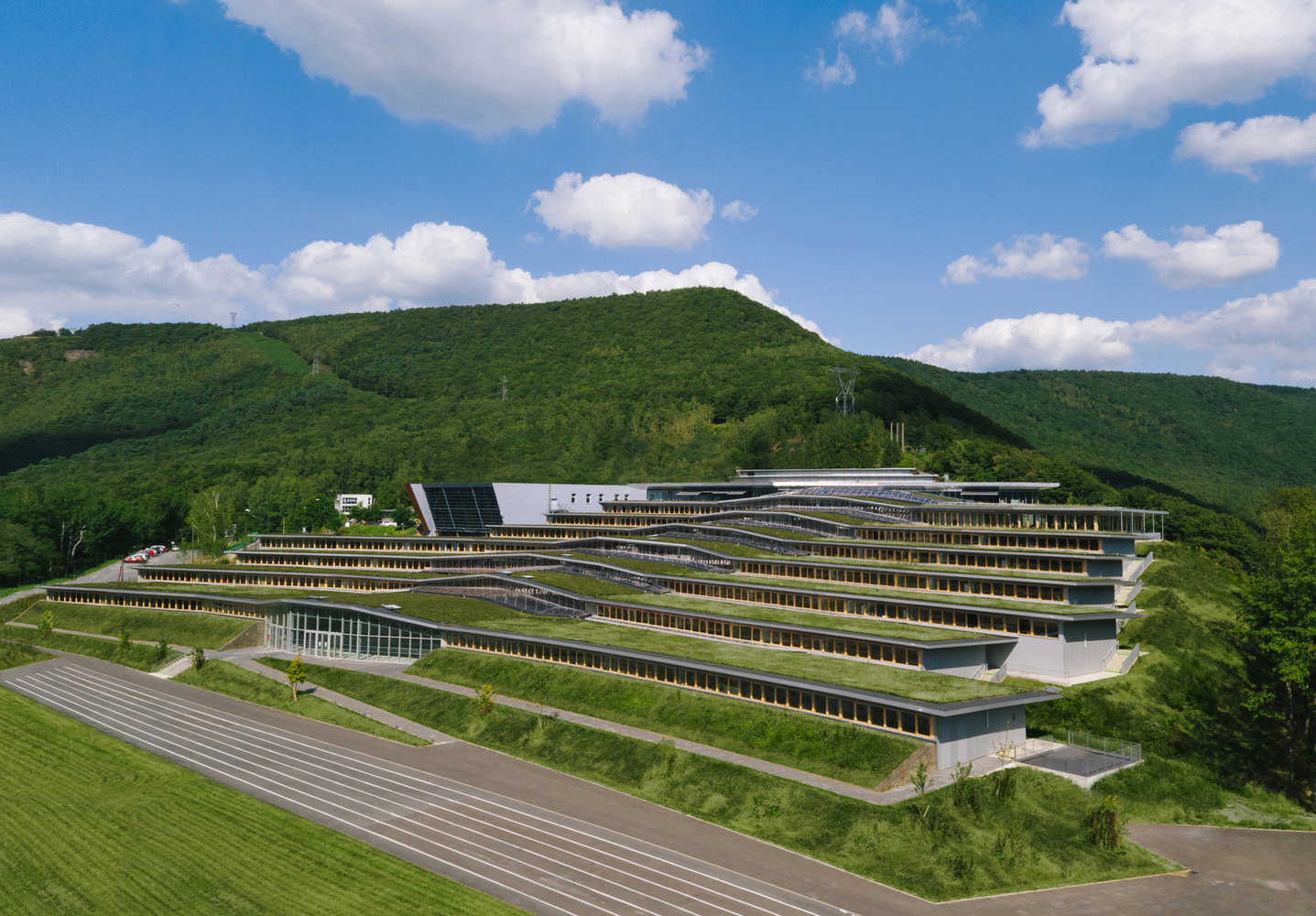 Incredible green-roofed school blends into the mountain landscape