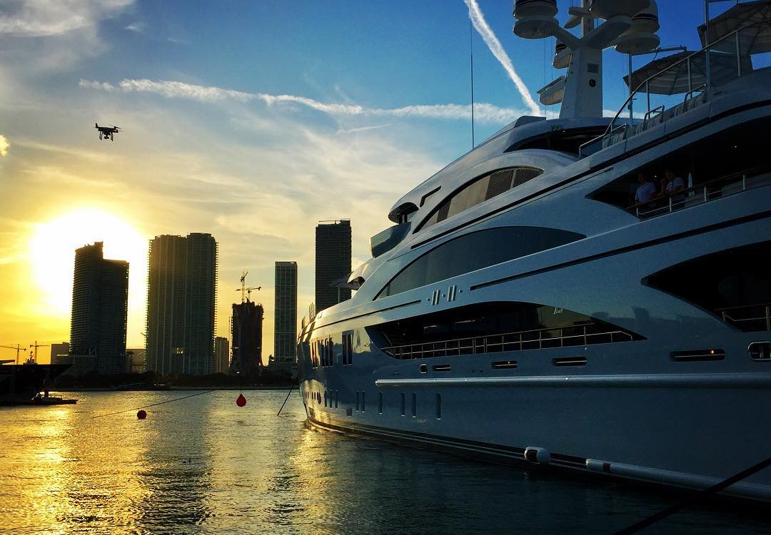 A yacht at the Deck at Island Gardens on Watson Island with the sun setting