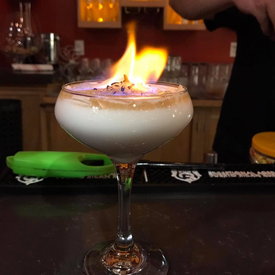 A flaming dessert cocktail at La Fábrica Central