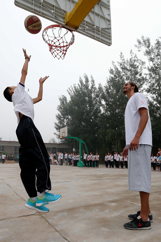 NBA Celebrities Visit A Primary School For Children Of Migrant Workers