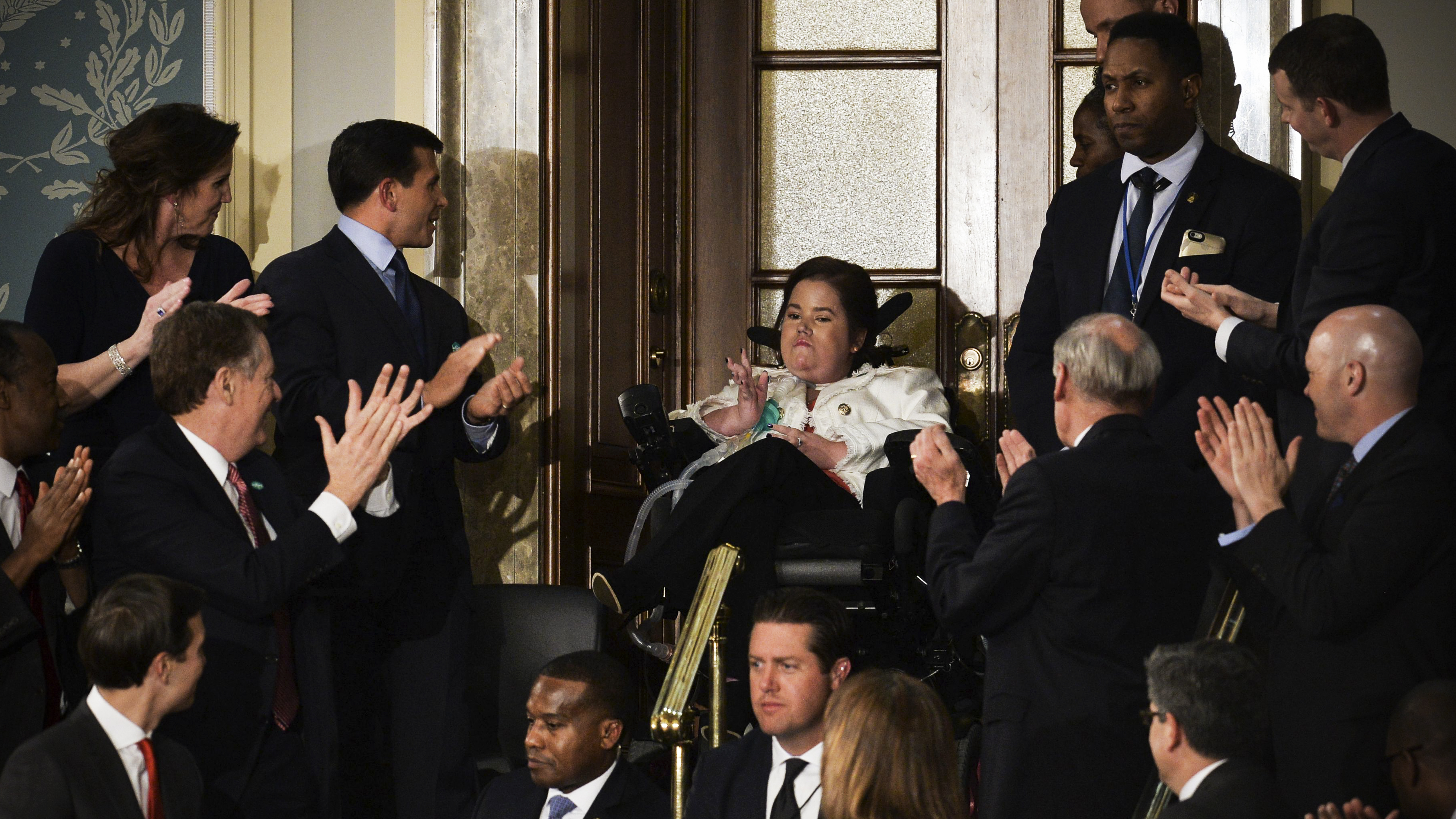 Megan Crowley (C) is applauded as US President Donald Trump addresses a joint session of the US Congress on February 28, 2017 at the Capitol in Washington, DC.<br>At 15 months old, Megan was diagnosed with Pompe Disease and not expected to live more than