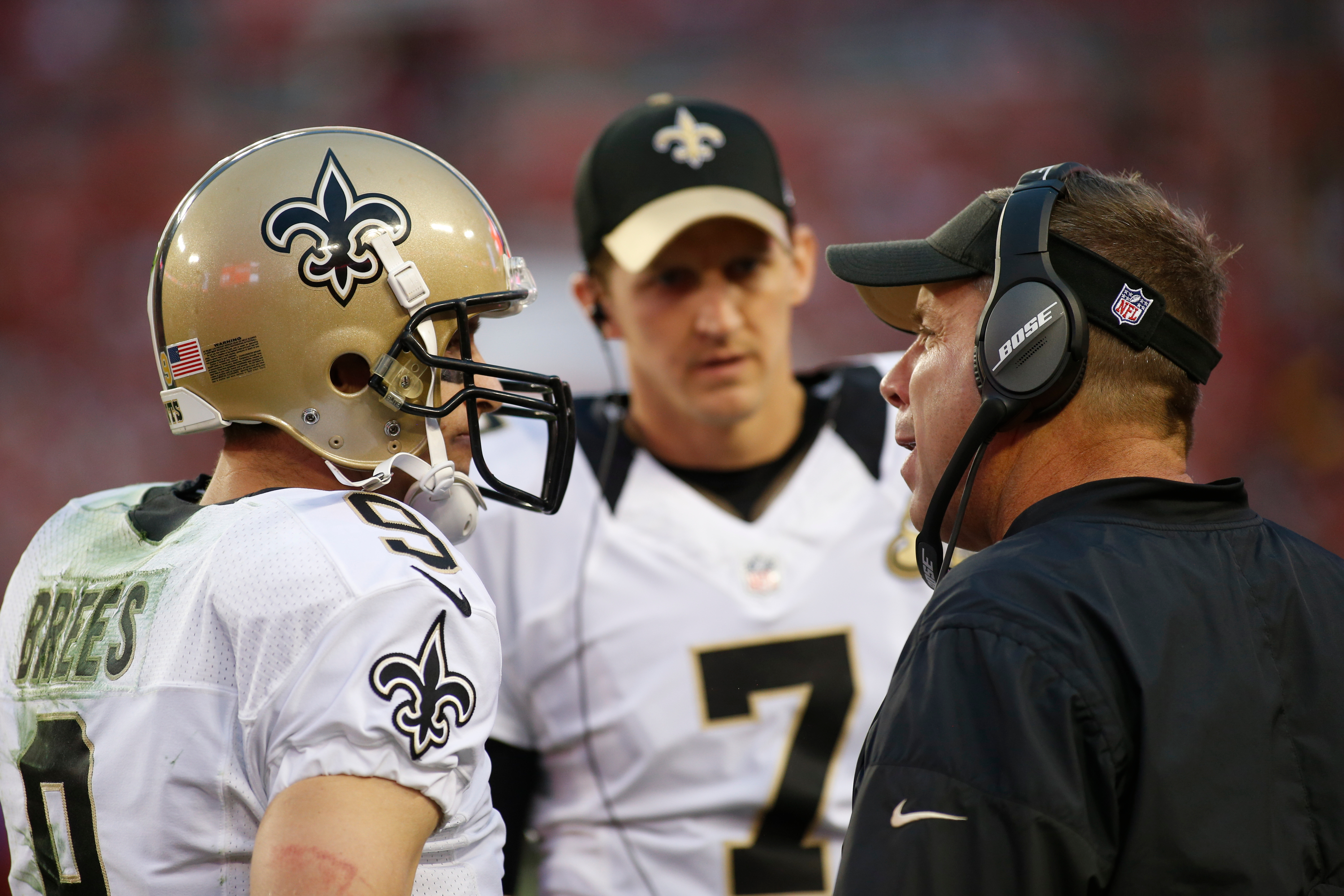 TAMPA, FL - New Orleans Saints head coach Sean Payton speaks with quarterbacks Drew Brees (9) and Luke McCown (7) during a game against the Tampa Bay Buccaneers at Raymond James Stadium.