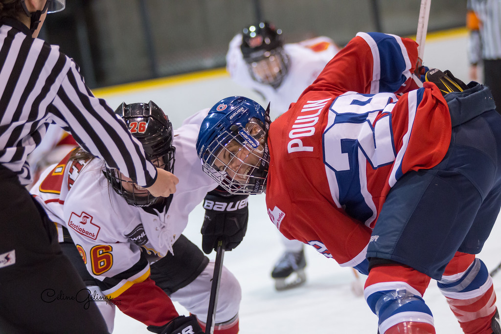 Marie-Philip Poulin of the Canadiennes de Montreal faces off against Calgary Inferno's Blayre Turnbull during the 2016-17 season.