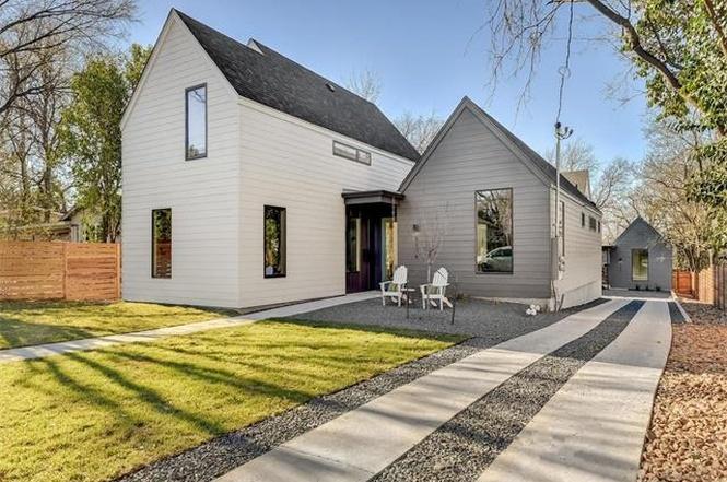 Large white modern farmhouse next to smaller gray modern farmhouse