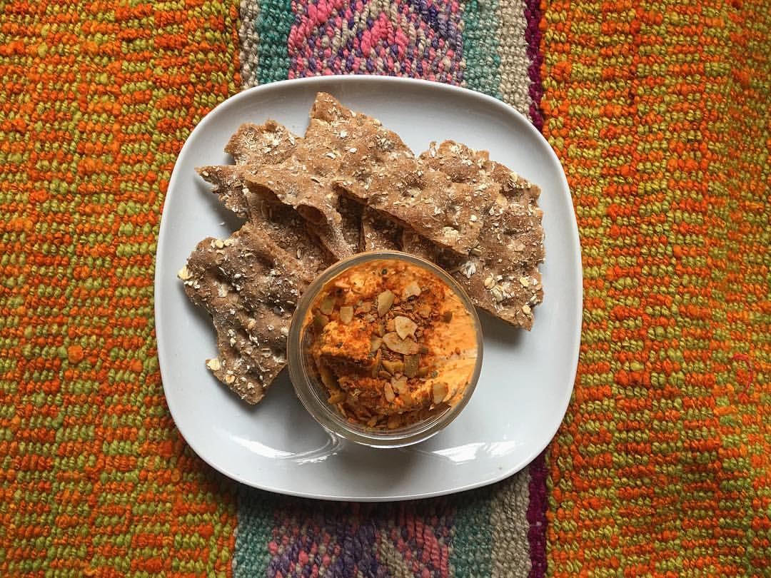 Aji rocoto goat cheese with spiced pepita-topped crackers from Killa Wasi