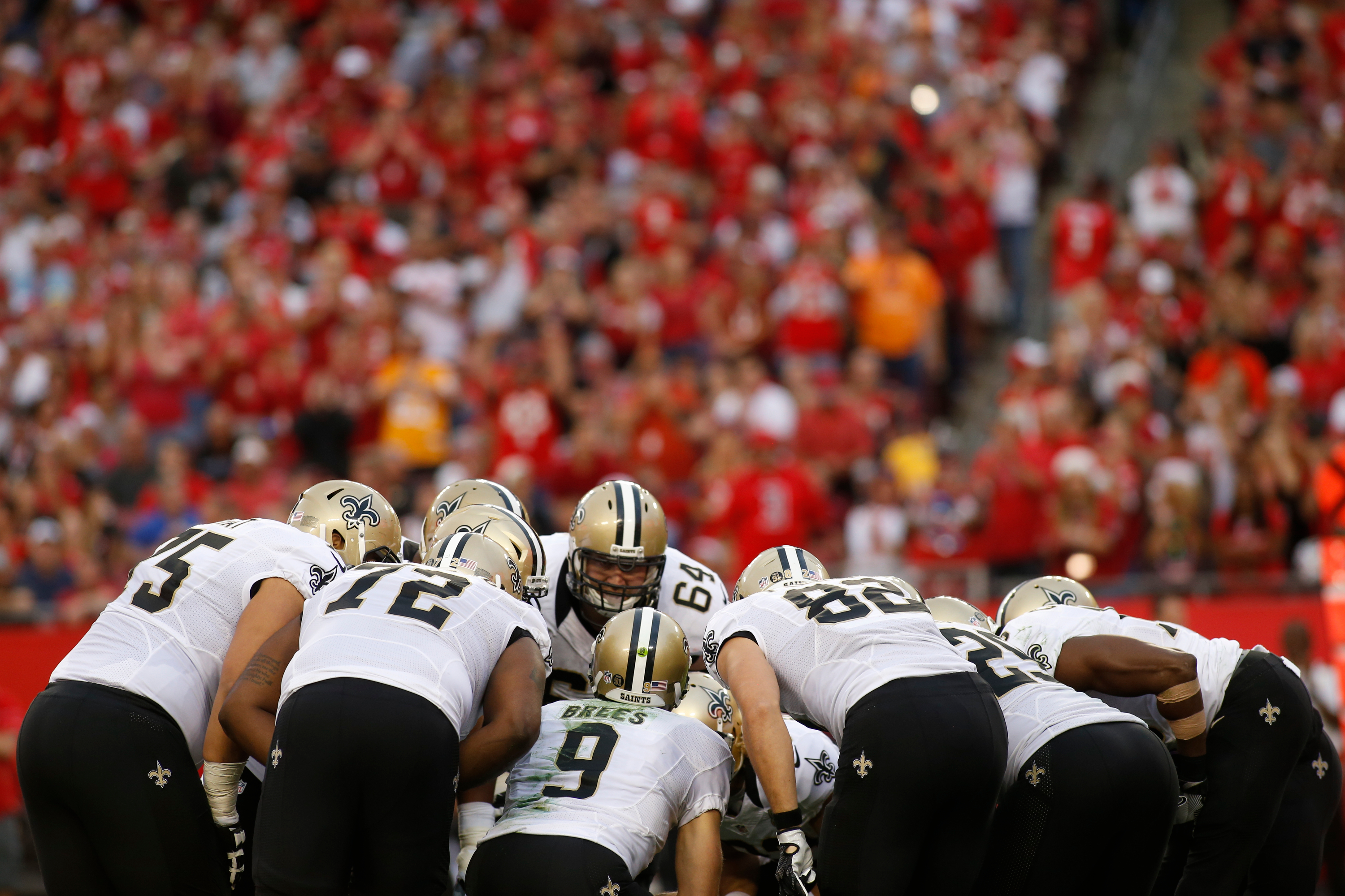 TAMPA, FL - New Orleans Saints quarterback Drew Brees (9) huddles the offense during a game against the Tampa Bay Buccaneers at Raymond James Stadium.