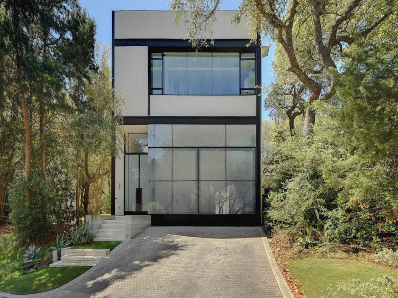 Three-story contemporary, white (stucco?) with lots of glass, all right angles