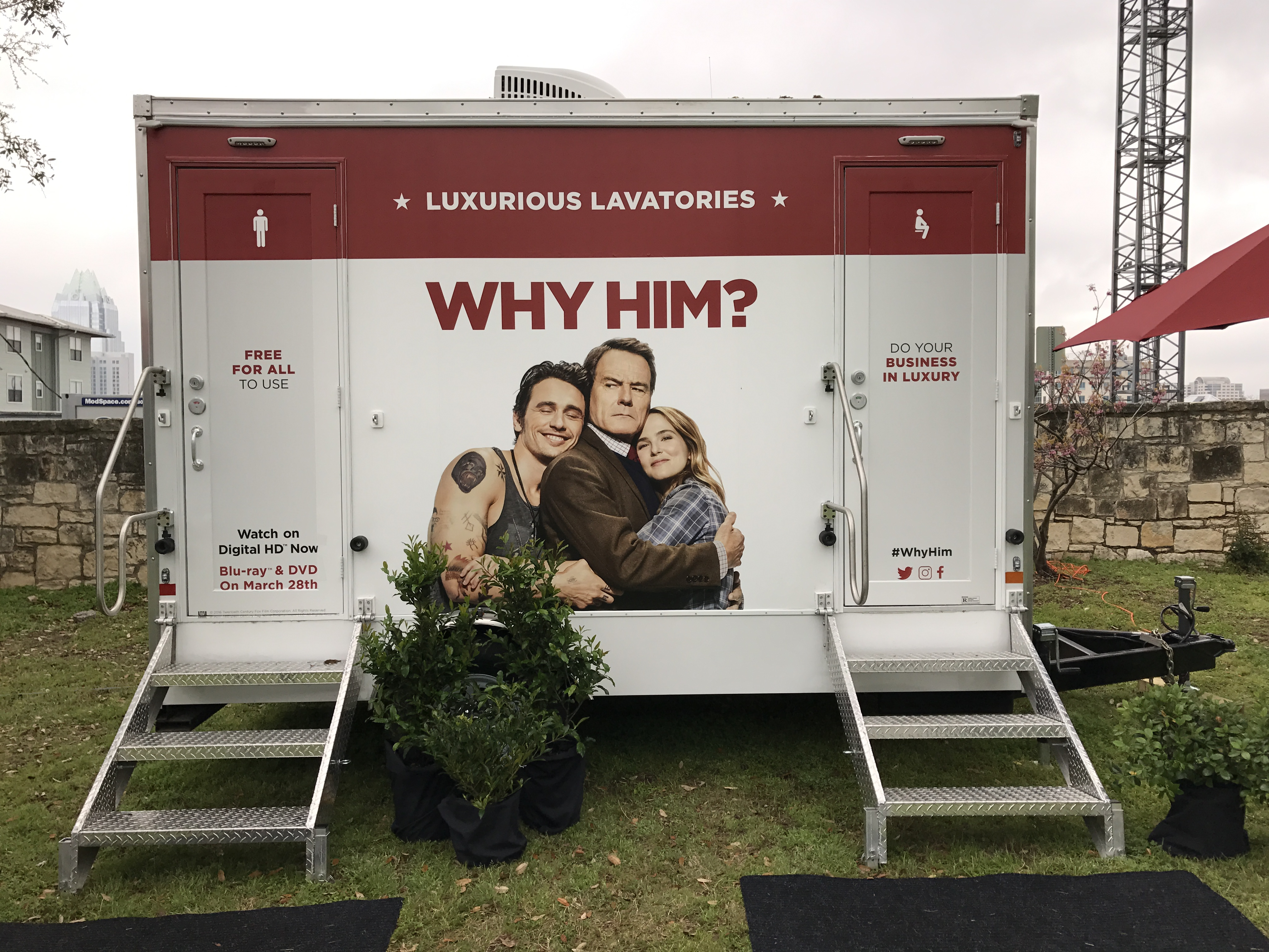 Portable trailer with two doors, stairs, wrapped with Why Him movie promotional photo