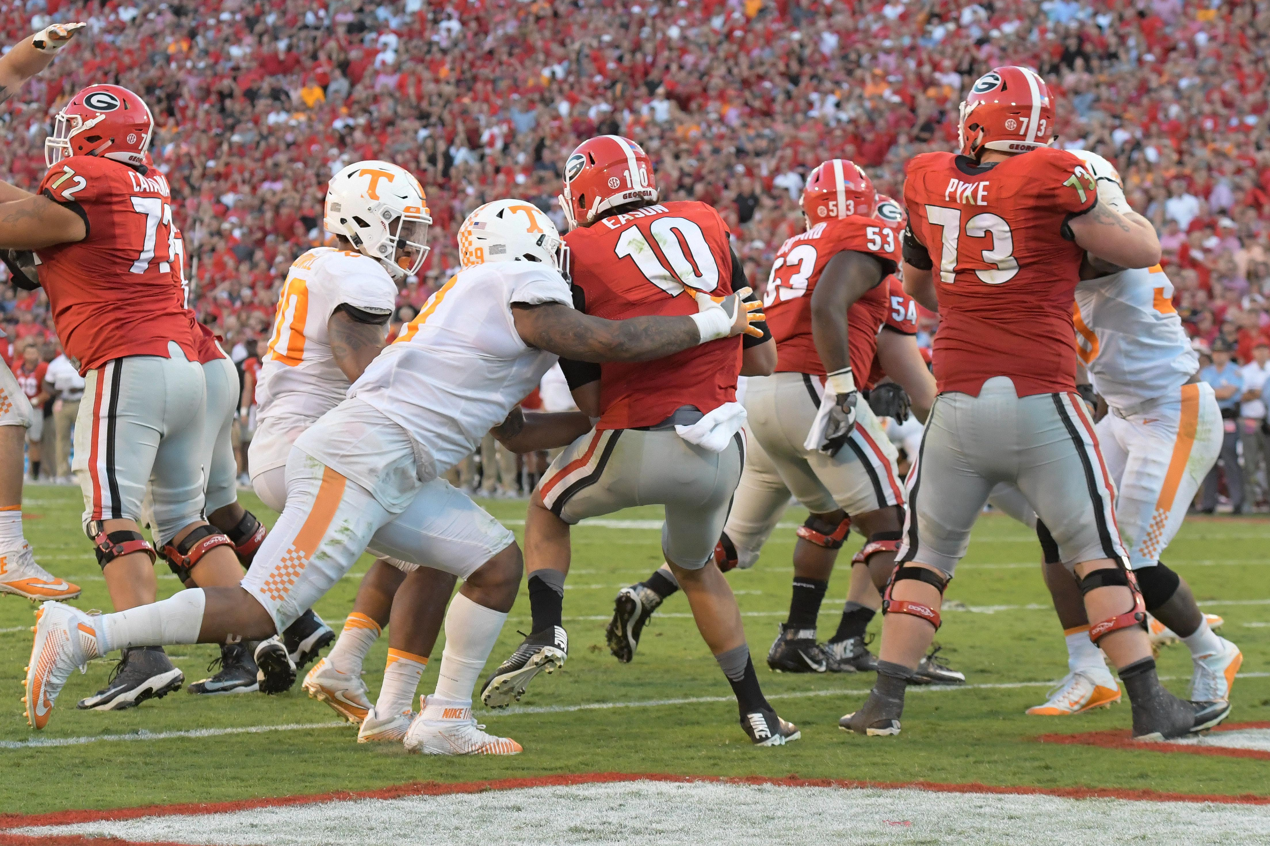 ATHENS, GA - Tennessee Volunteers pass rusher Derek Barnett (9) forces a sack-fumble out of Georgia Bulldogs quarterback Jacob Eason (10) at the goalline at Sanford Stadium.