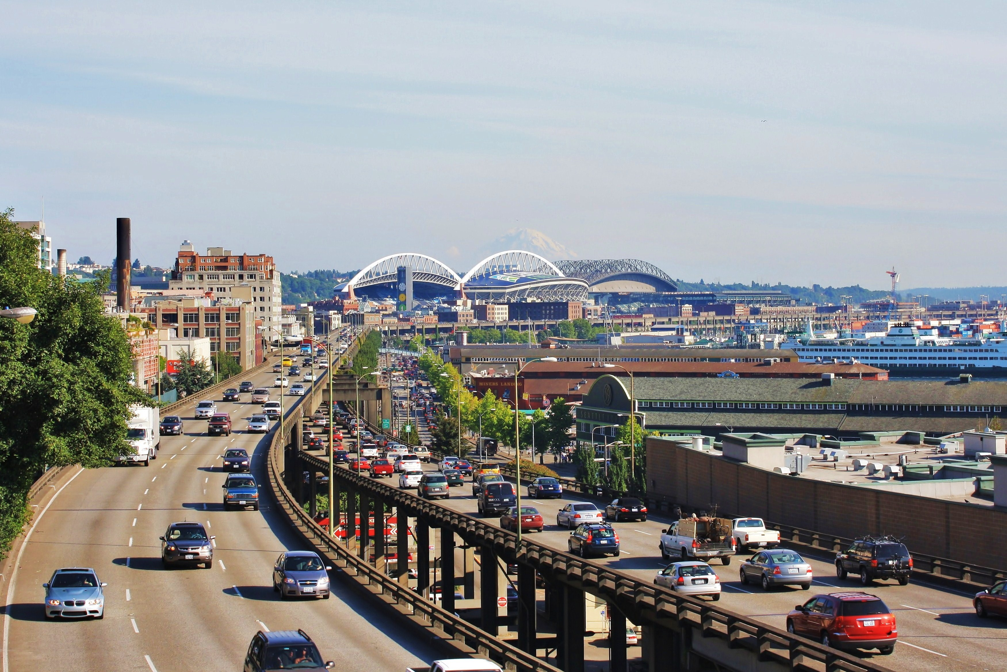 Cars travel in both directions on the Alaskan Way Viaduct in a photo taken from the north. Both CenturyLink and Safeco Fields are visible in the background.