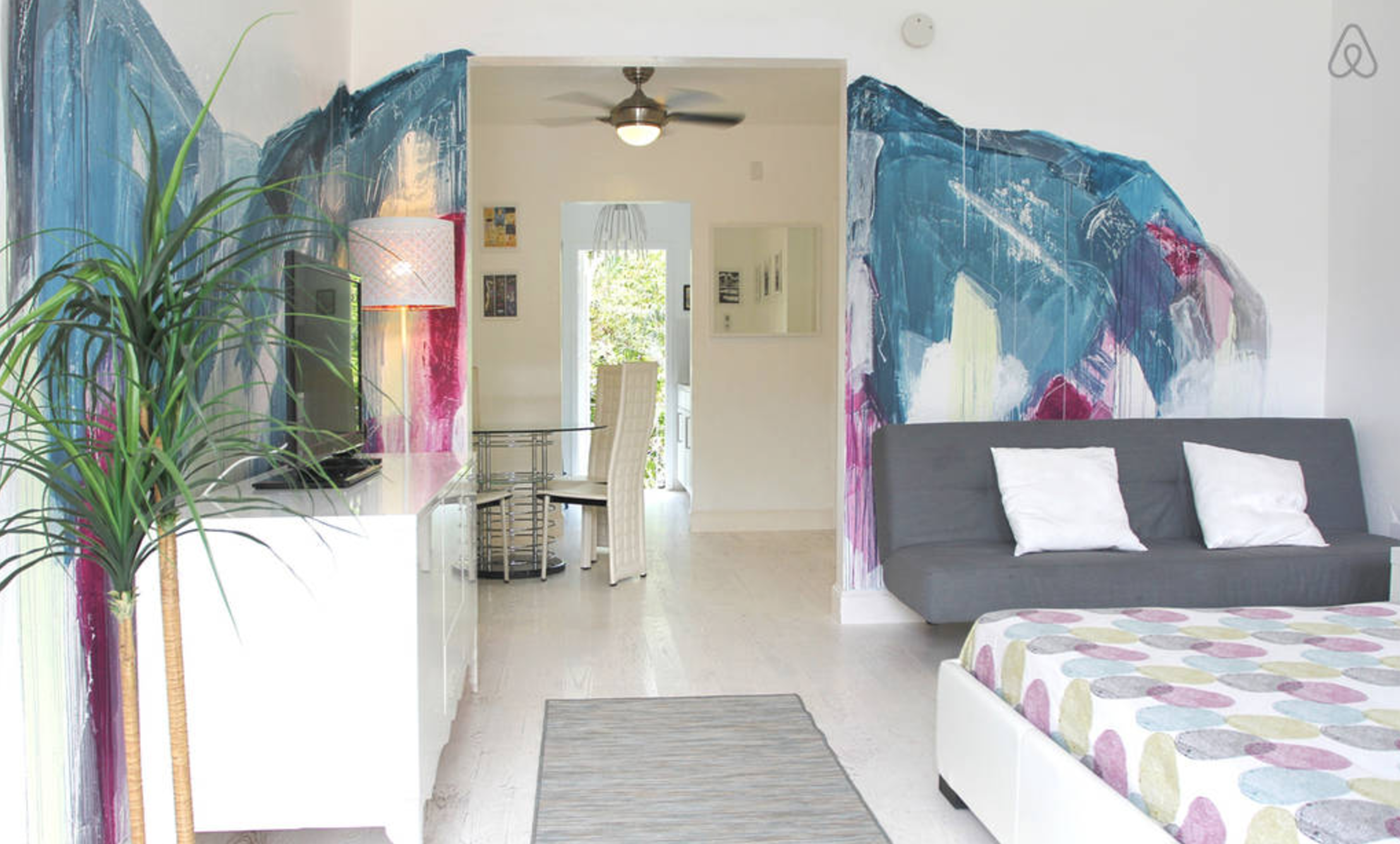 A studio on airbnb in Miami Beach with a wall mural and white modern interiors