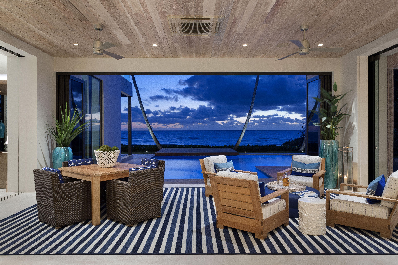 The beachfront view inside 1115 Hillsboro Mile, a contemporary new build an ocean for a backyard