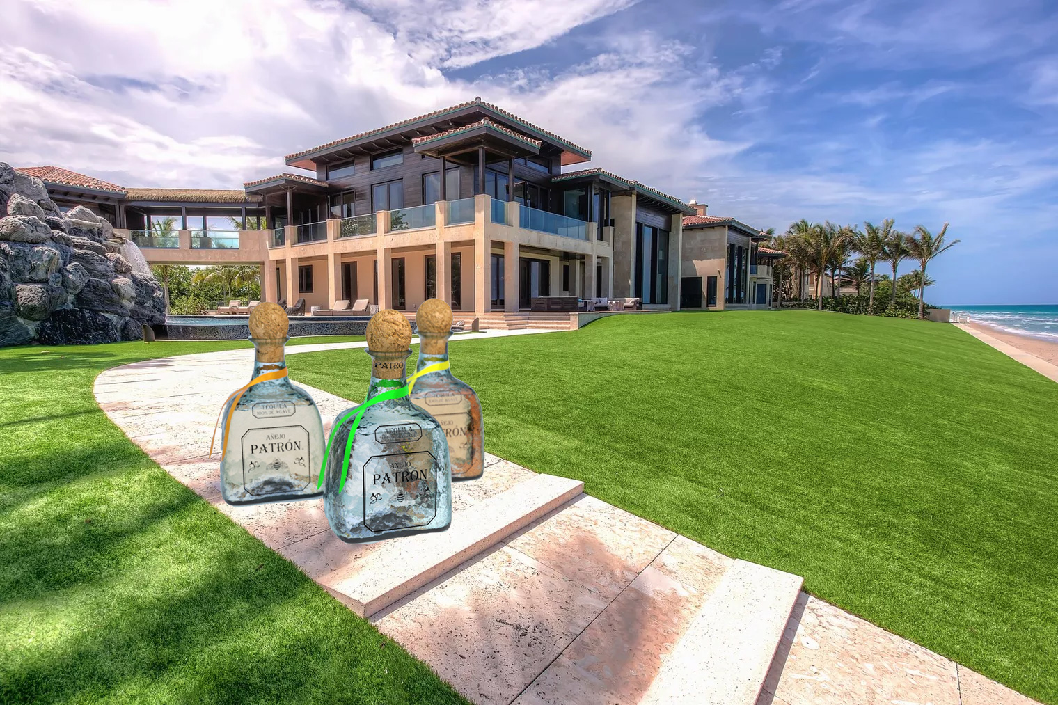 The South Florida beach mansion of Patron CEO Edward M. Brown with patron bottles on the lawn and a ocean in the backyard