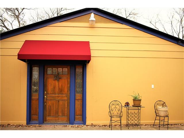 Garage apartment exterior—one story, yellow, red awning