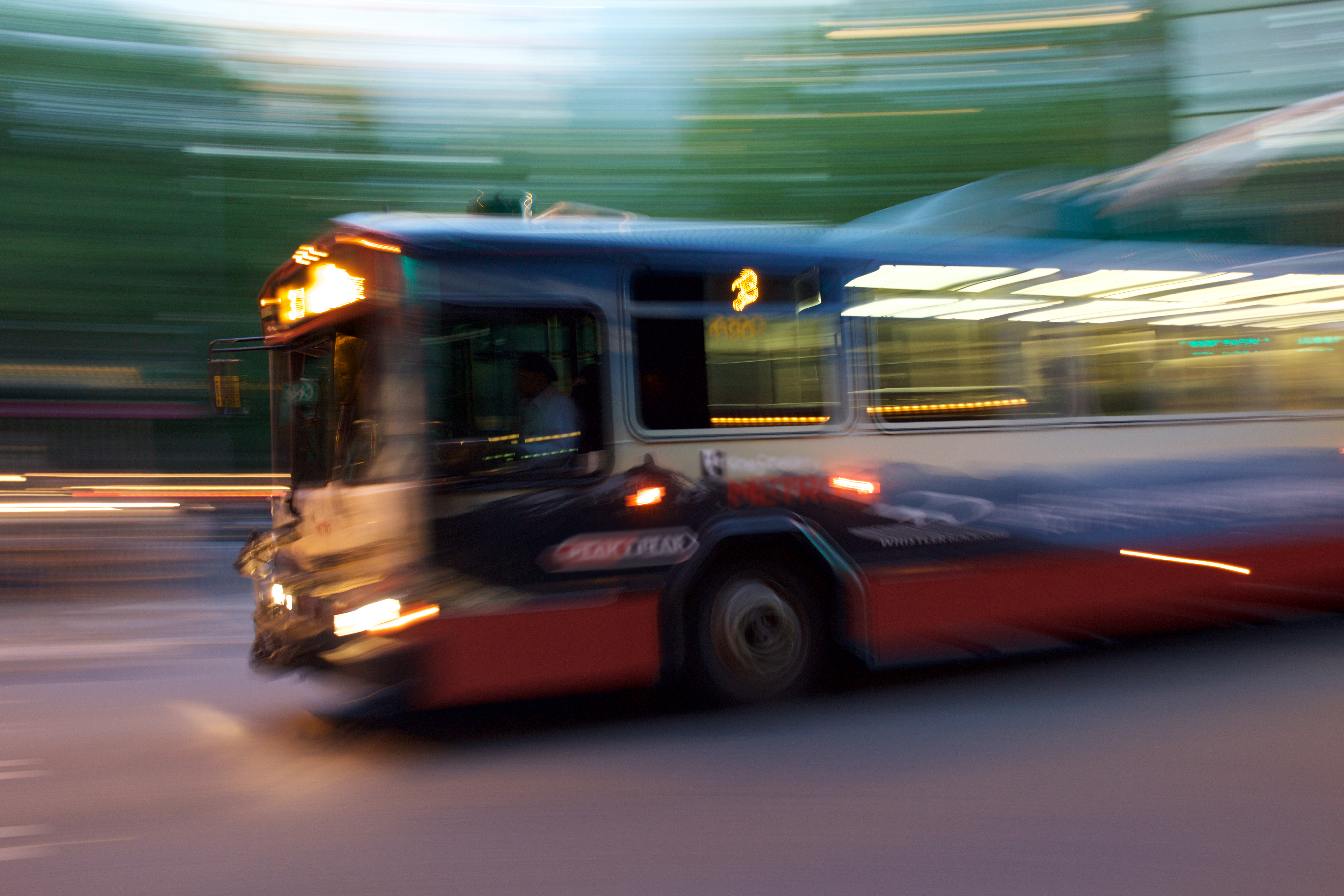 Blurry photo of a Number 3 bus at night