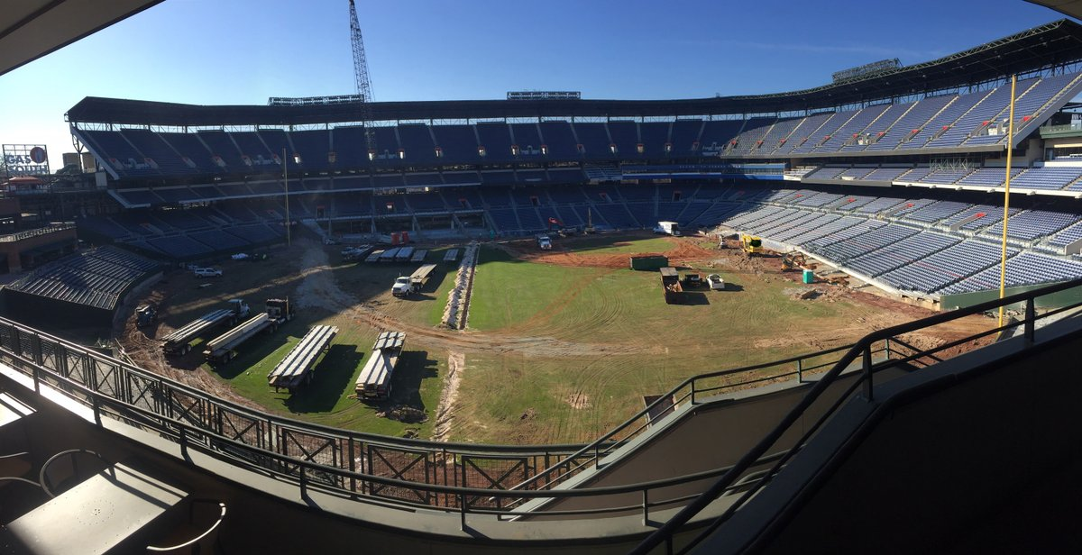 Work crews remove sections of seating.