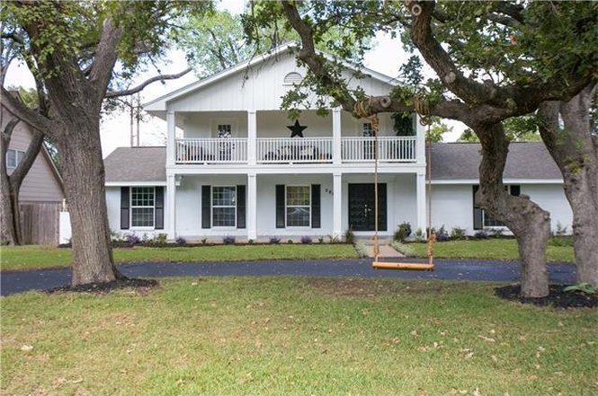 Large white two-story frame house with big front porch, columns, veranda on second story