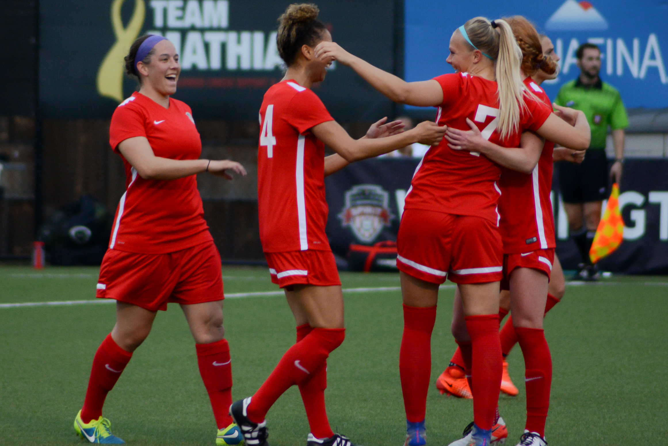 Washington Spirit players celebrate following Line Sigvardsen Jensen's goal