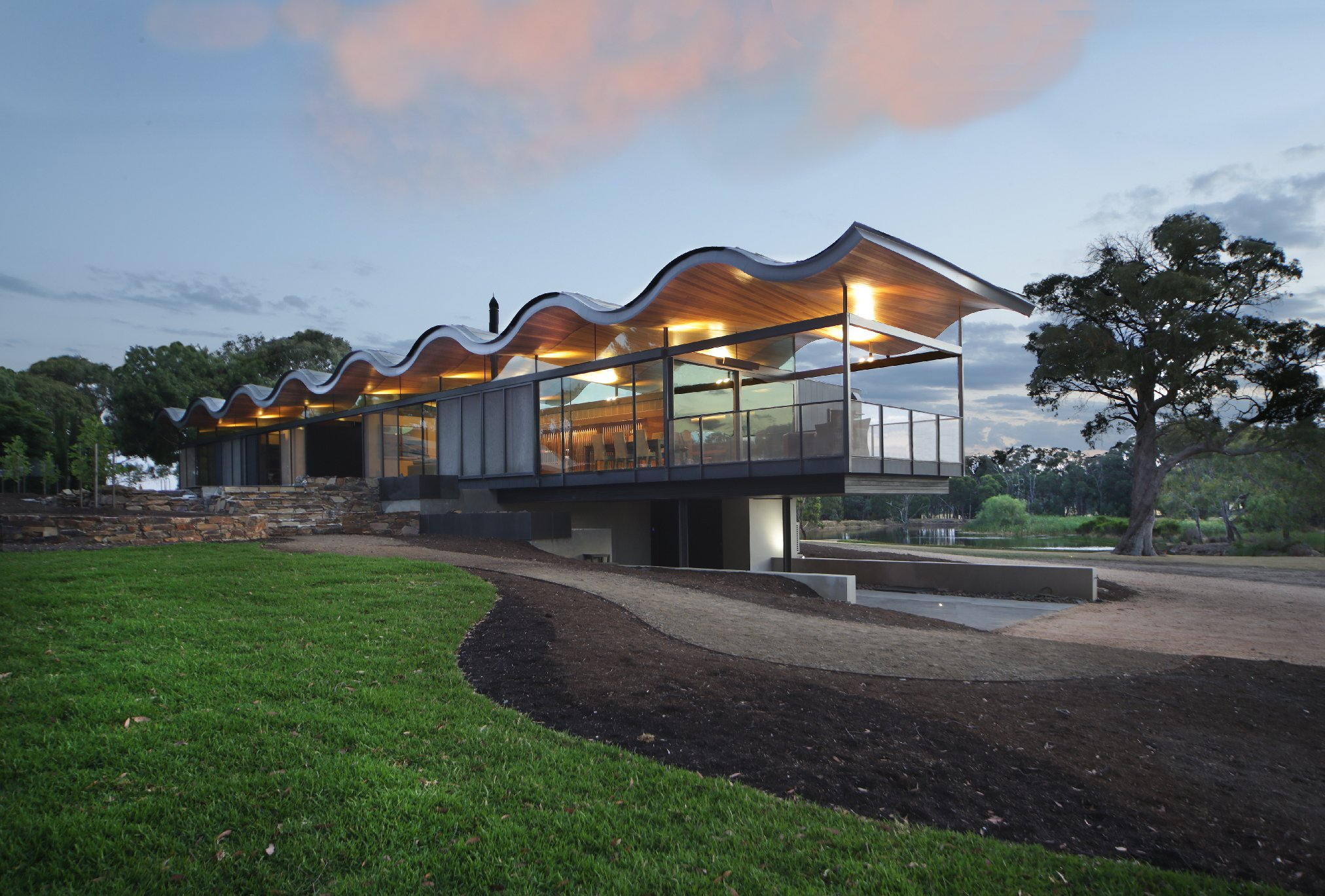 modern glass house with wavy roof