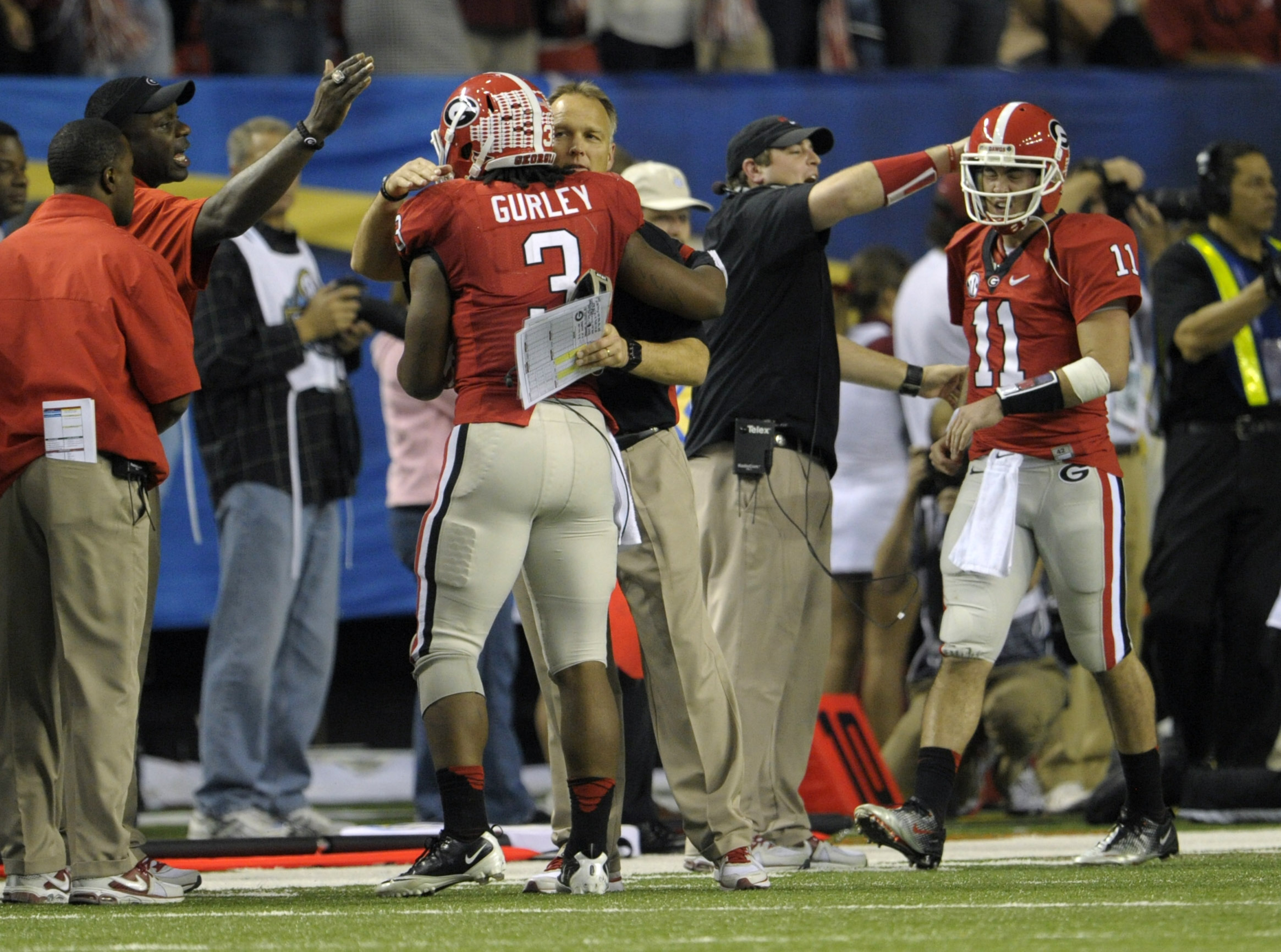 Mark Richt is seen here reassuring Todd Gurley that the sun will in fact come up tomorrow.