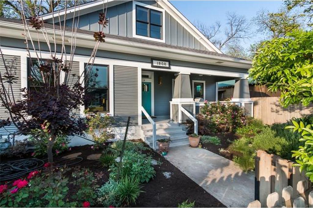 Gray frame Craftsman with white trim, front garden