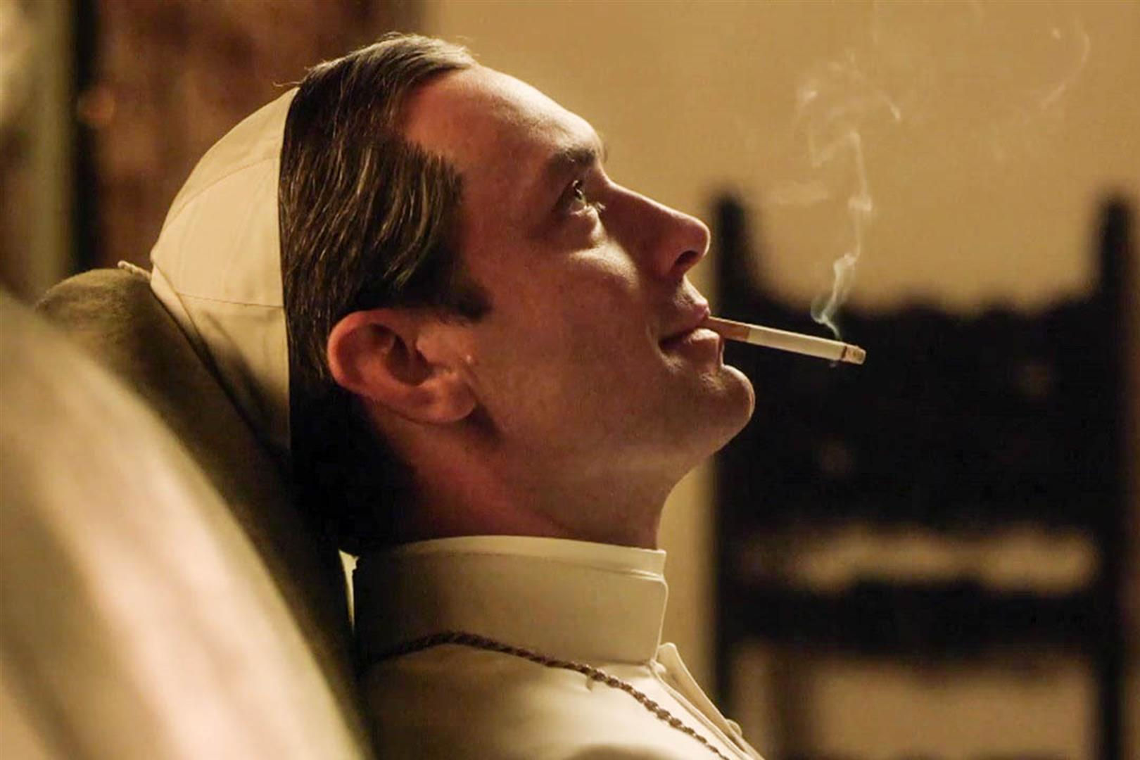 """Actor Jude Law smokes a cigarette as """"The Young Pope"""""""