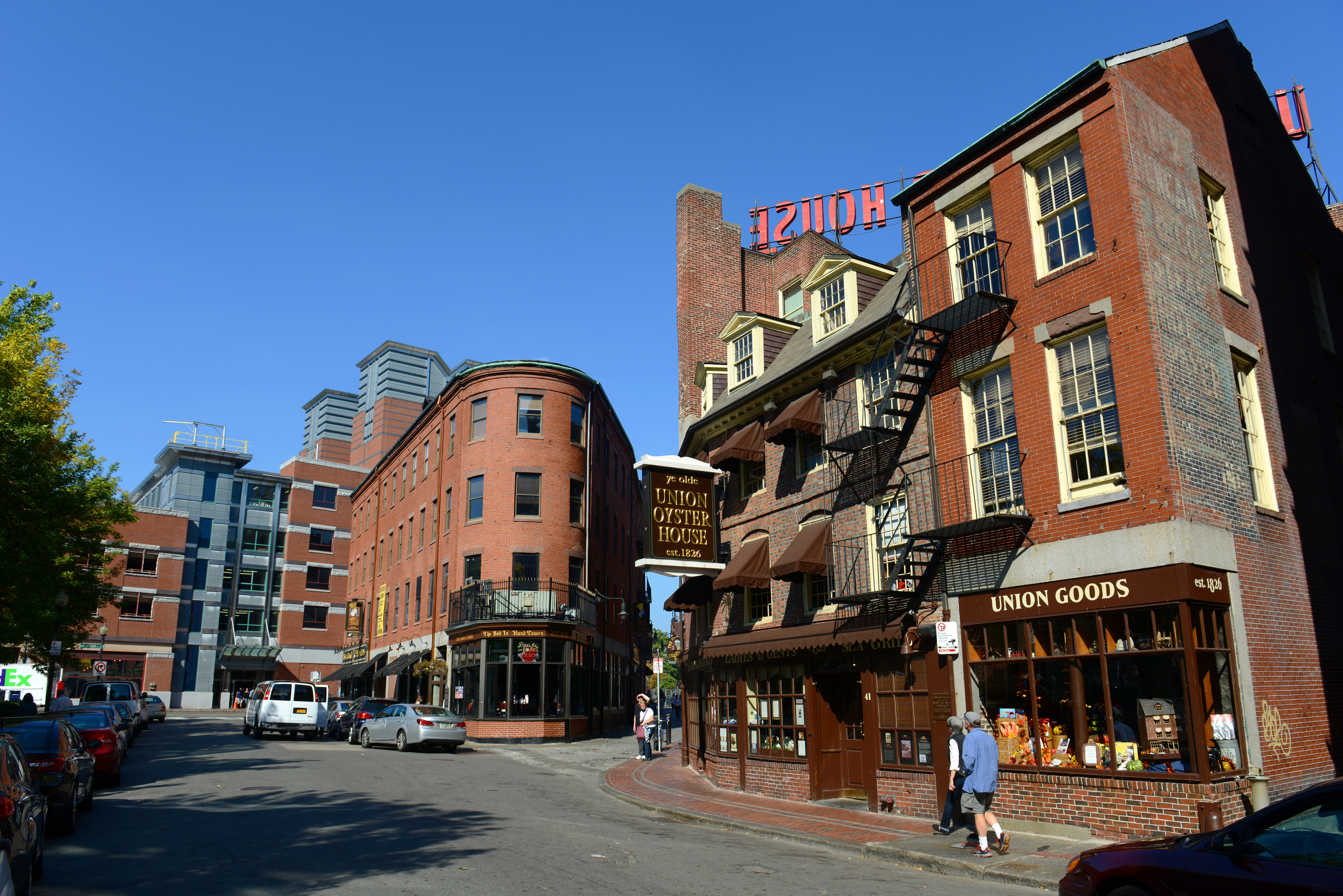 The exterior of a three-story building that houses a restaurant on the first floor.