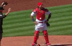 Yadier Molina got a baseball stuck to his chest protector, and it's weirder than it sounds