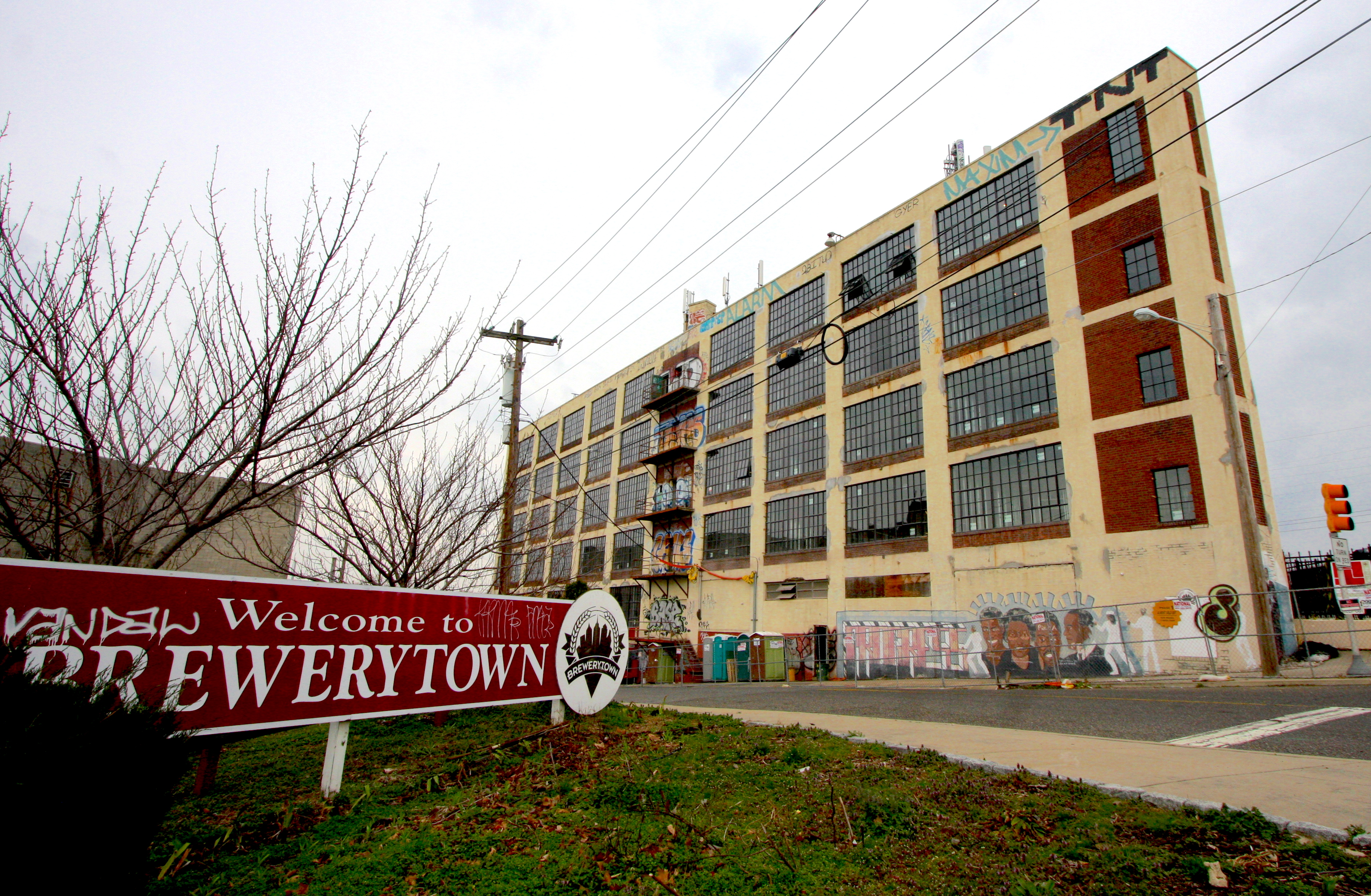 The graffiti-laden Pyramid Electric building in Brewerytown is being converted into 50 rental units and commercial space.
