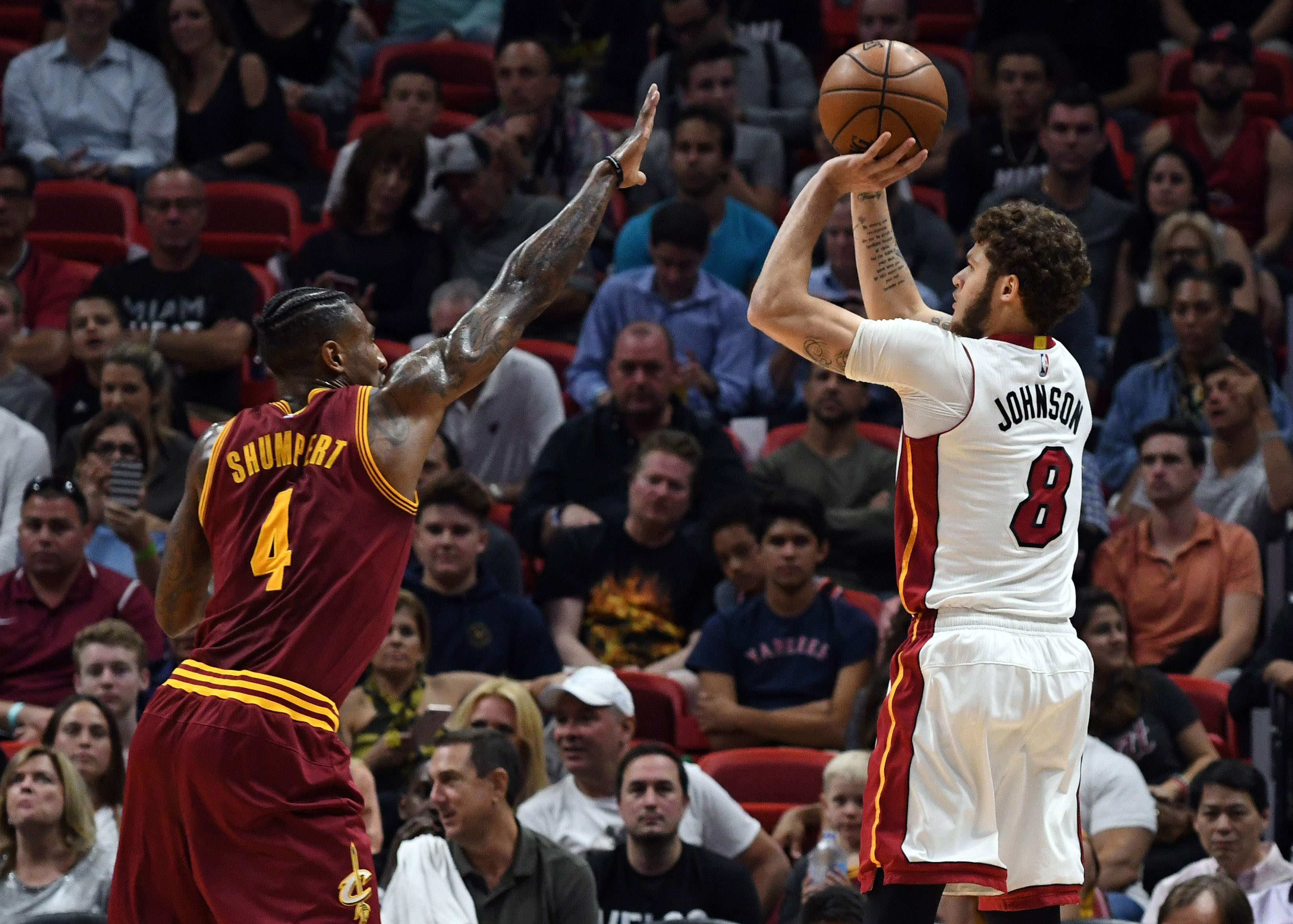 Heat keep playoff hopes alive with OT win against Cavaliers