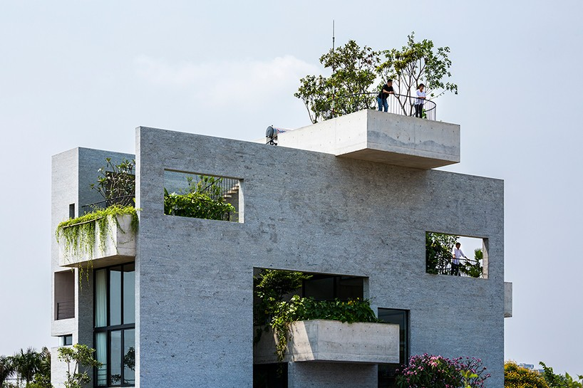 concrete house with vegetated terraces