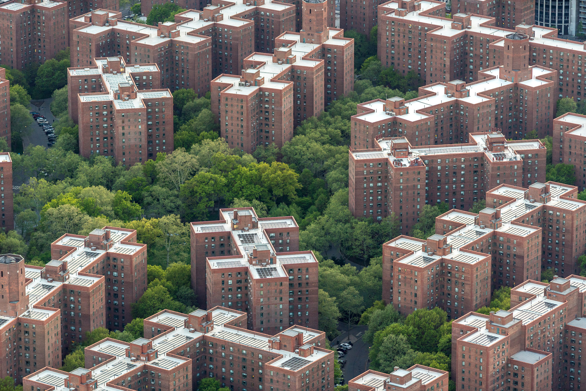 An aerial view of apartment buildings and trees.