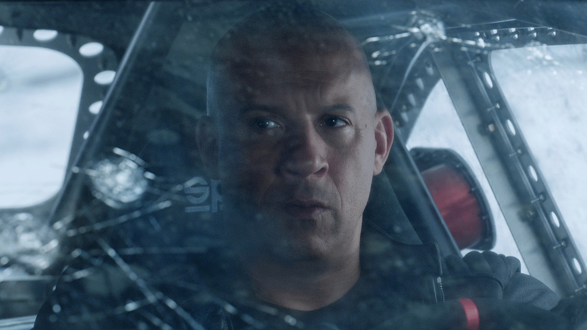 a close-up of Dominic Toretto (Vin Diesel) at the wheel in Fate of the Furious