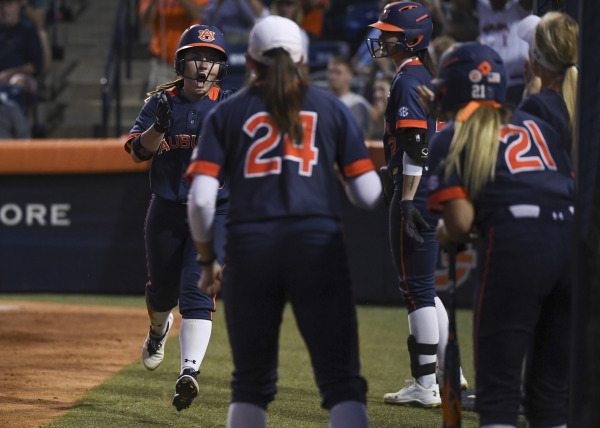 Carlee Wallace celebrates with teammates Saturday night after scoring.