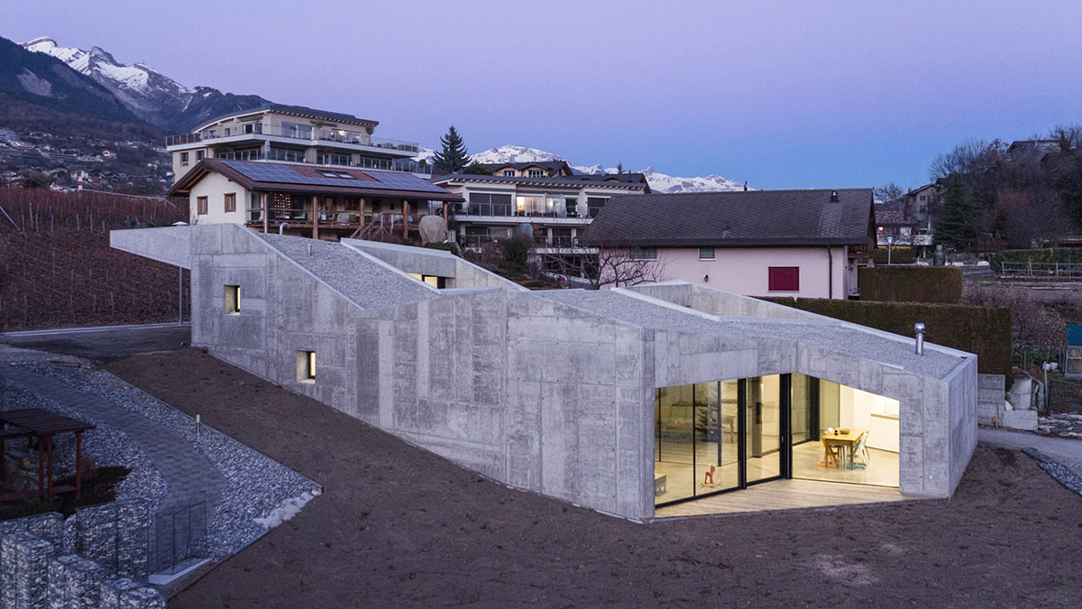 Rad Concrete House Climbs Up A Small, Sloping Site