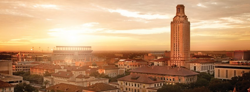 wide shot of UT campus, Main tower on right, football stadium on left, at sunset