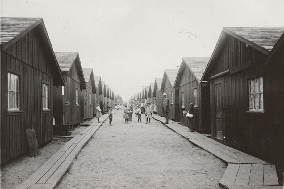 Refugee children posing between rows of cottages in Franklin Square