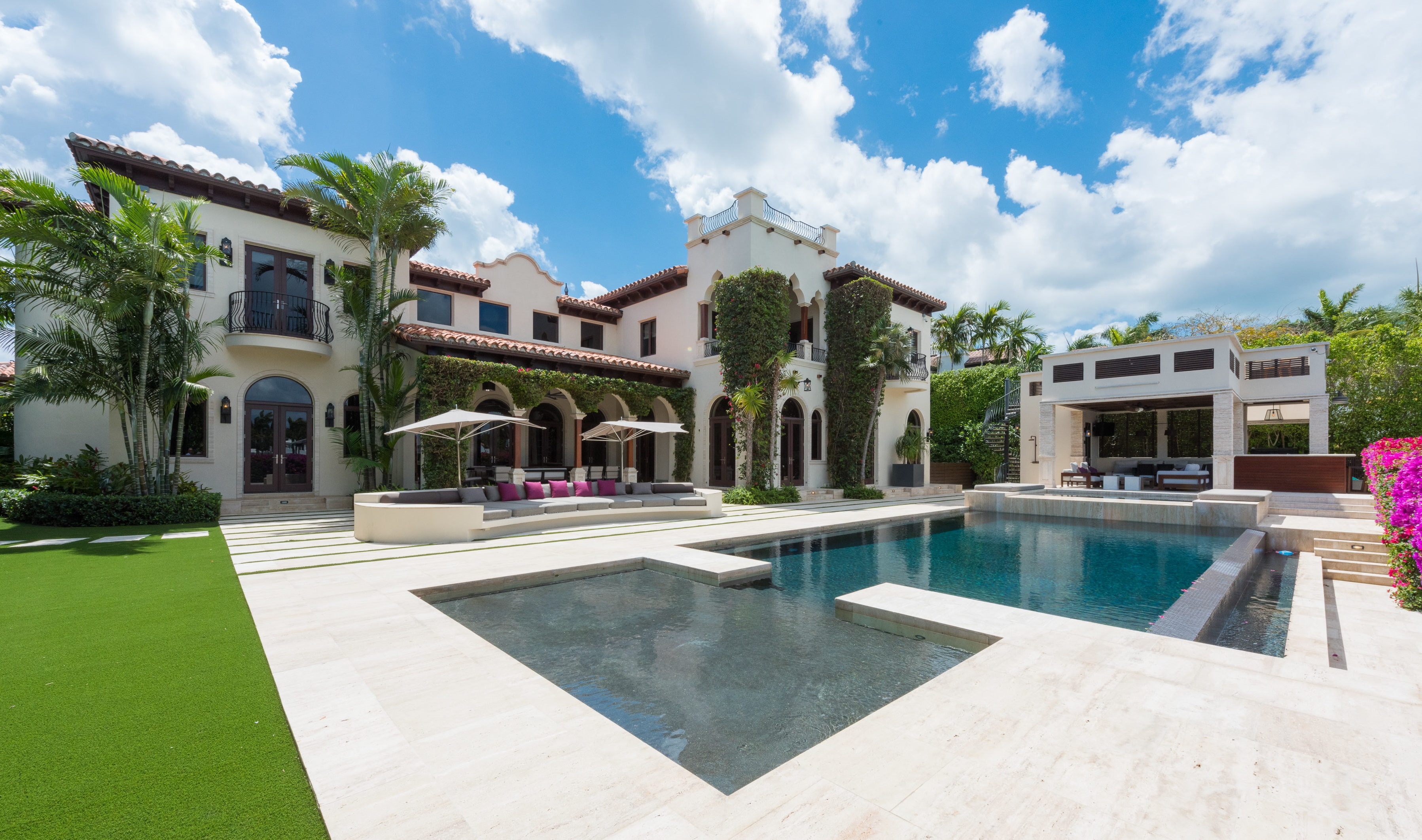 Backyard view of a massive Mediterranean mansion in Miami Beach