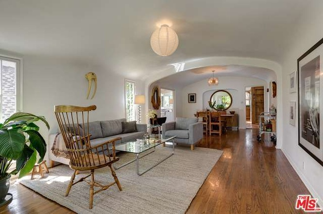 Living room and dining room with hardwood floors