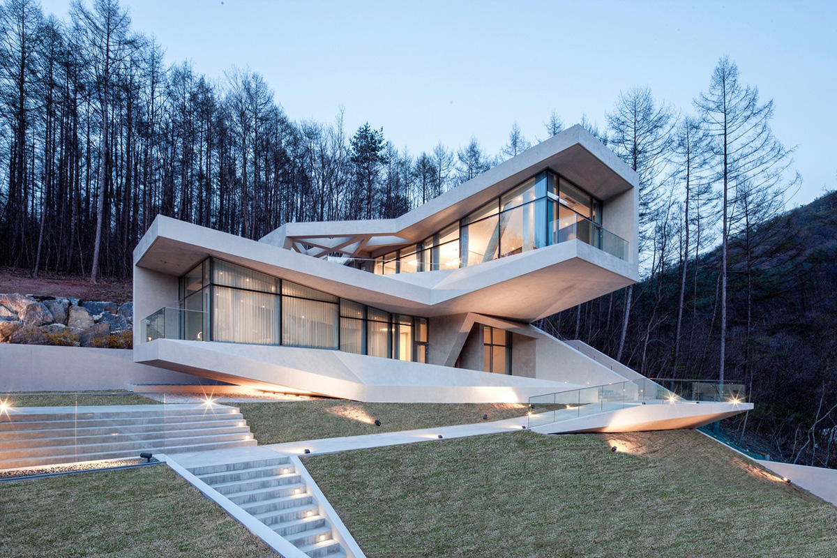 Concrete home brings wild geometry to lush valley