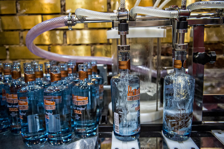 Vodka bottles being filled at Old 4th Distillery.