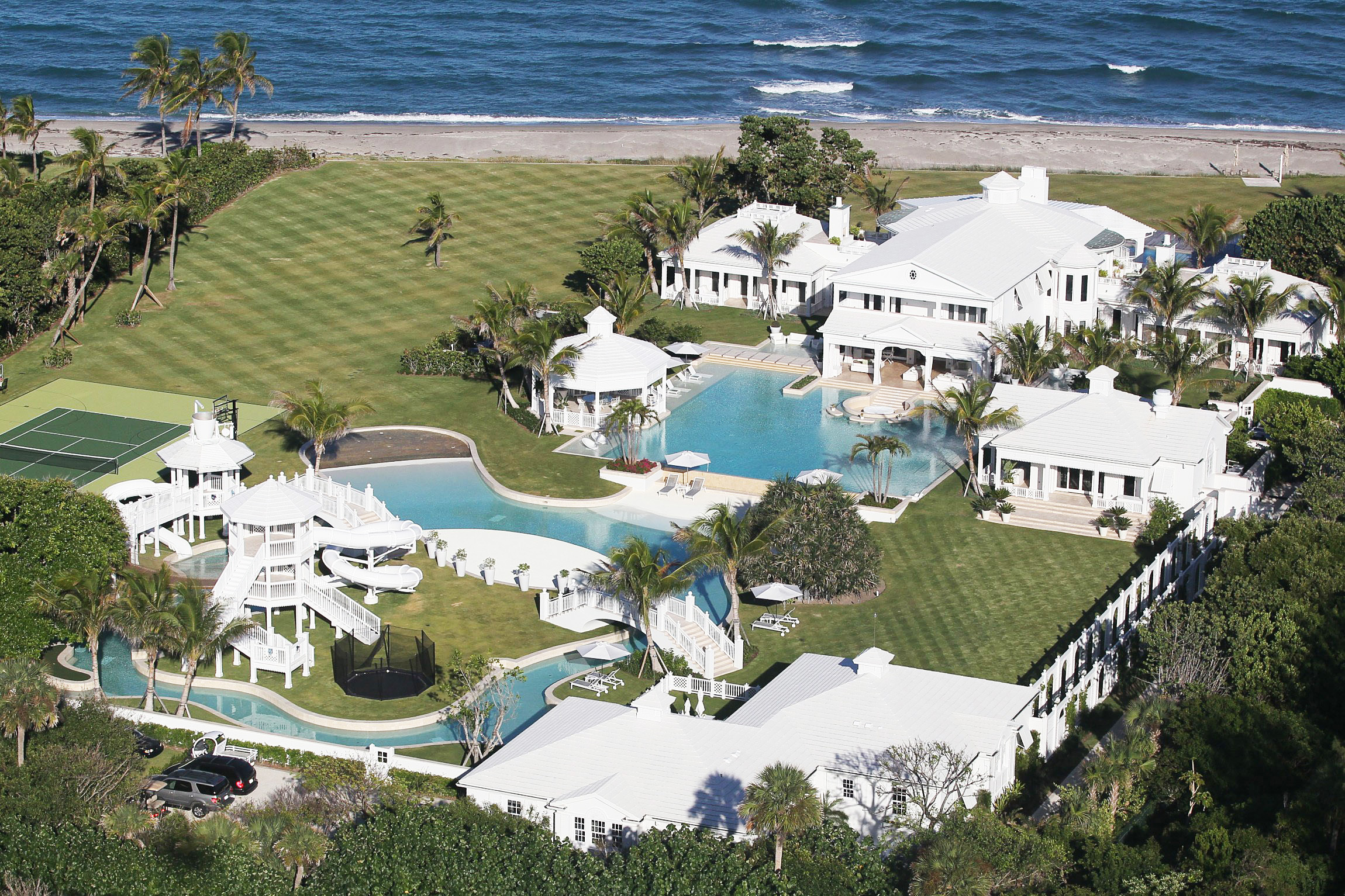 An aerial of an oceanfront home with a water park
