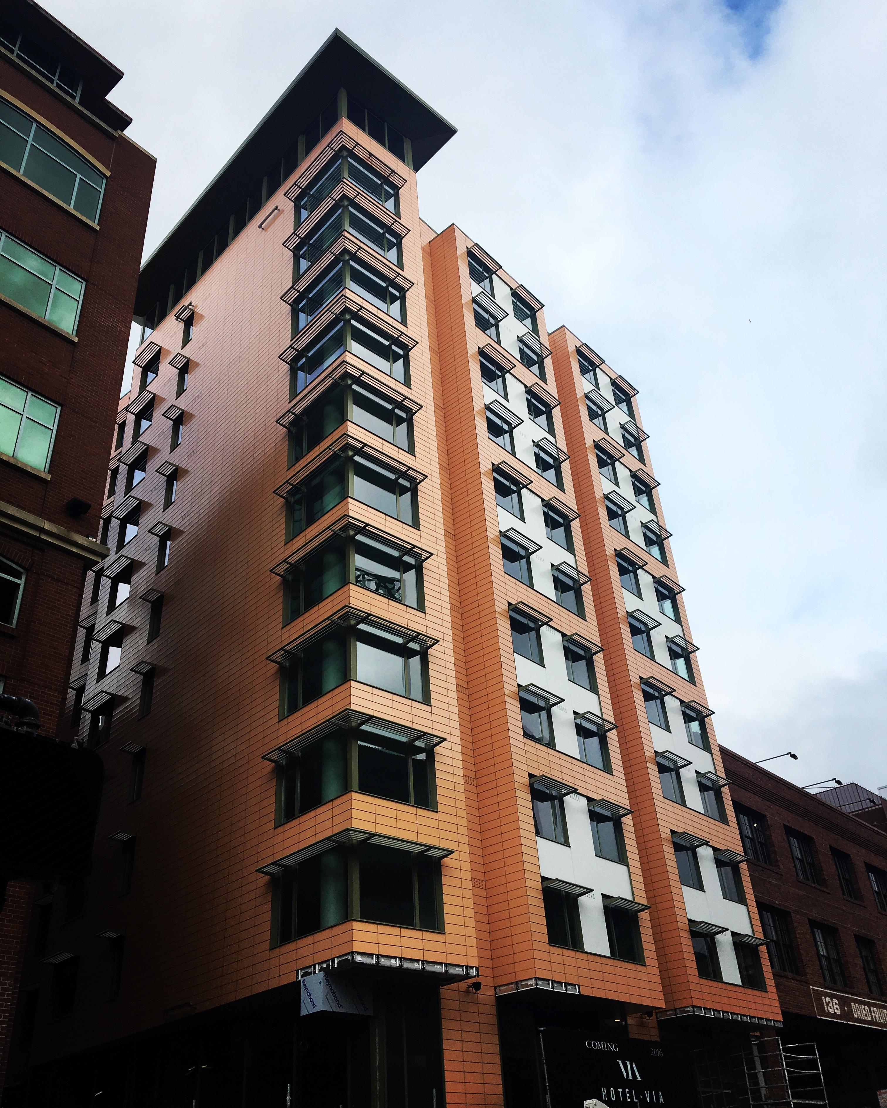 Exterior of 12-story hotel, very contemporary.