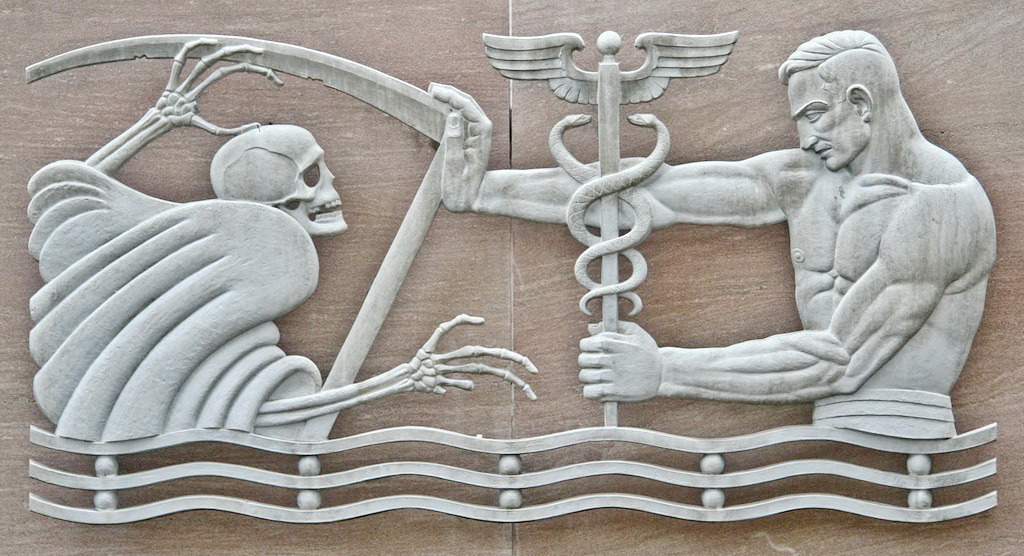 A grey bas-relief showing a man pushing away the Grim Reaper.