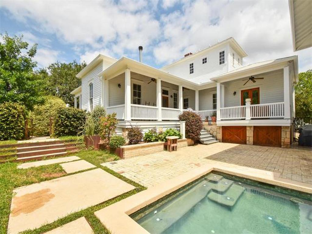 1900 2-story white frame house with big porches and pool in front