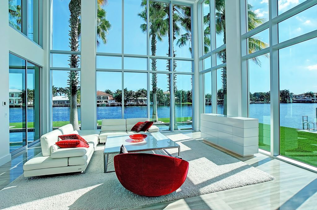 a modern glass interior living area in fort lauderdale overlooking the canal