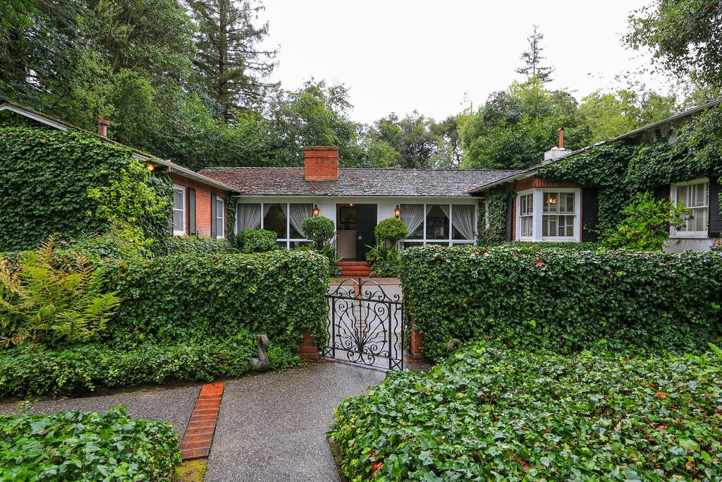 The vine-covered exterior of a mid-century home in Menlo Park.