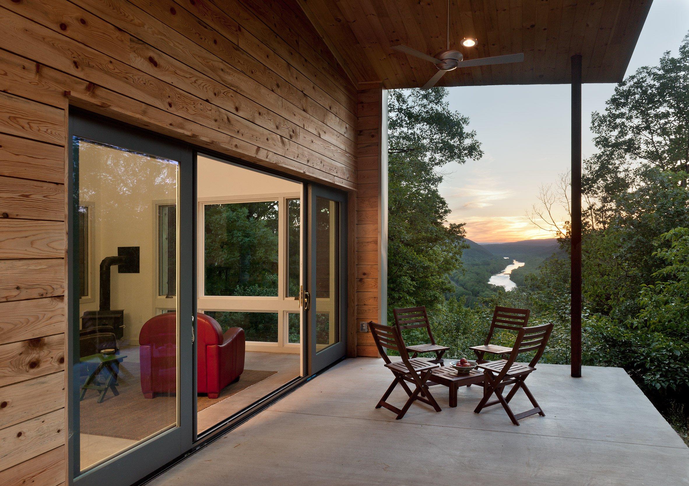 Exterior view of porch overlooking river valley below.