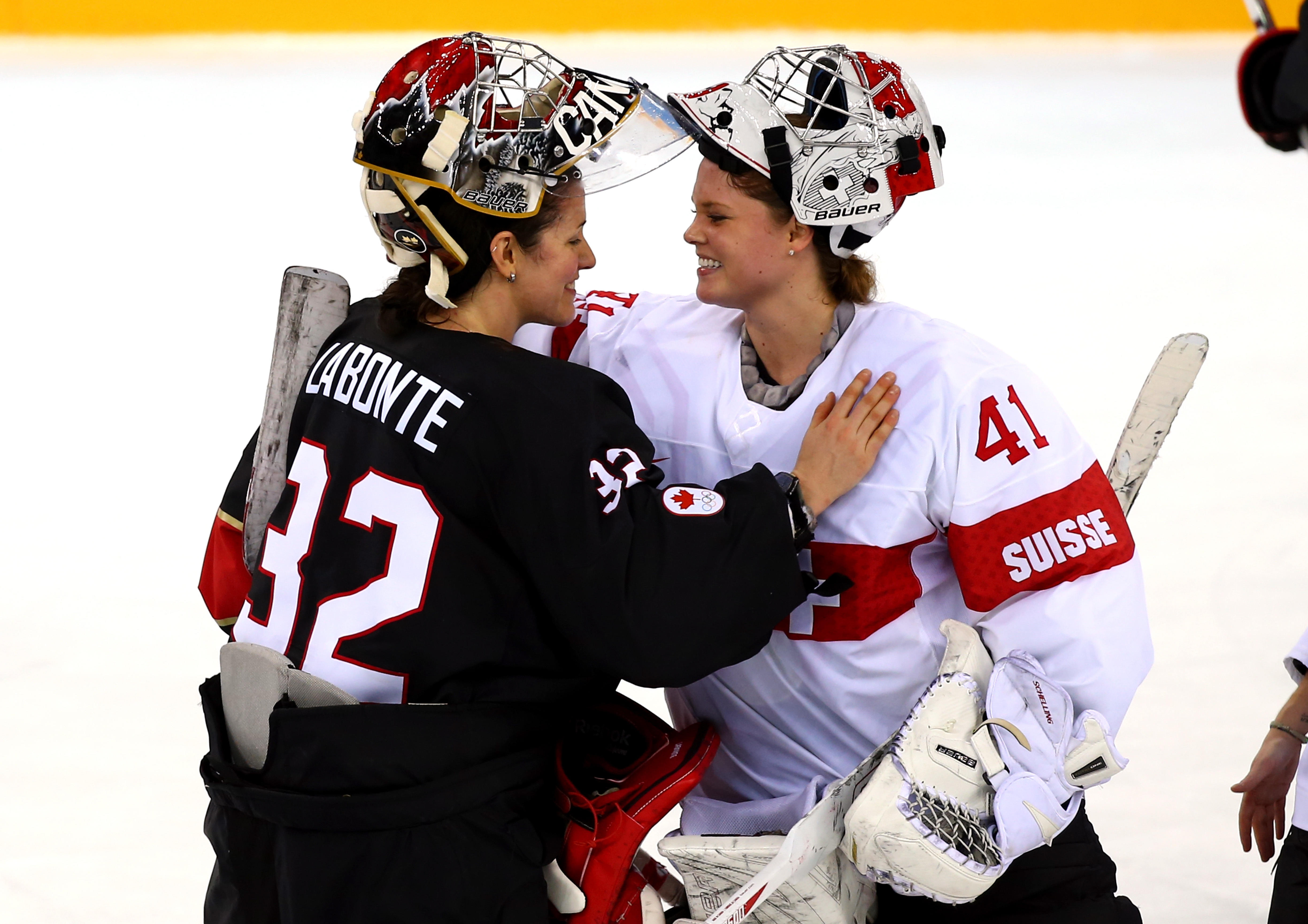 Charline Labonte (Montréal Stars) and Florence Schelling (Brampton Thunder) talk after Canada's 5-0 victory against Switzerland at Sochi