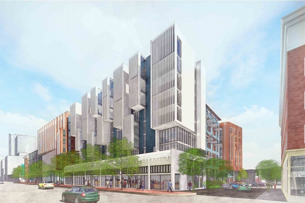 A rendering of a four-story building with a white and glass facade on Market.